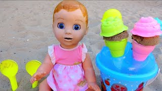 Baby doll playing with ice cream toys on the Playground. Video for kids - compilation.