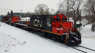 [4K] Very Old GP9 and Rare GMD1 Locomotives Hauling Local Freight Through Snowy Weather (01/30/2017)