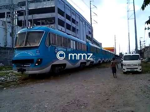 DOST-MIRDC Hybrid Electric Train (HET) and DEL 914 passing Alabang area
