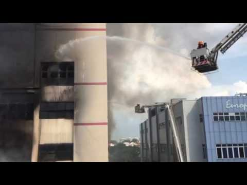 SCDF personnel using water jets on the C K Building fire