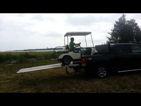 Golf cart being transport using EZ Slide Ramp