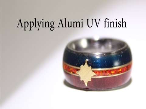 Applying Alumi UV finish to a wood and resin ring.