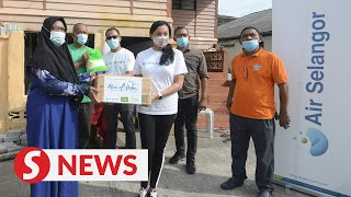 Utility company staff spruce up dilapidated village house