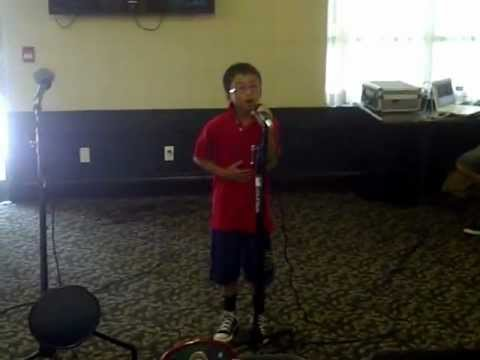 Let It Be Me, sung by 9 yr old Cyrus