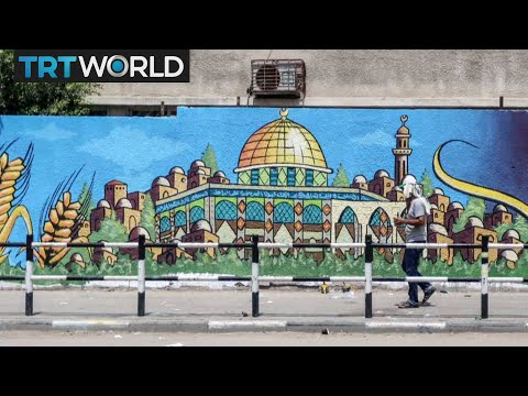 Palestinian artists paint Gaza streets in protest