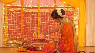 Beautiful Indian woman applying tika to Hindu God's idols and bowing head with namaskar - Pooja Background