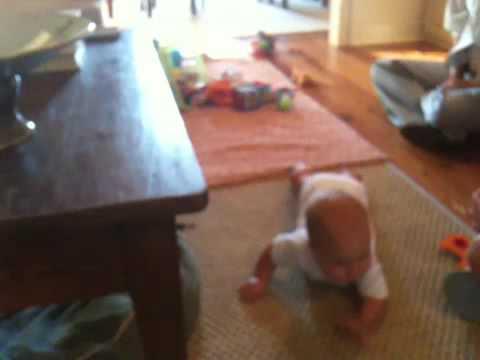Ann Baine learns to crawl.