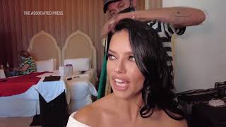 AP Exclusive: Watch model Adriana Lima get ready for the Venice International Fi