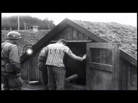 A US soldier talks with liberated prisoners at a Nazi concentration camp in Lands...HD Stock Footage