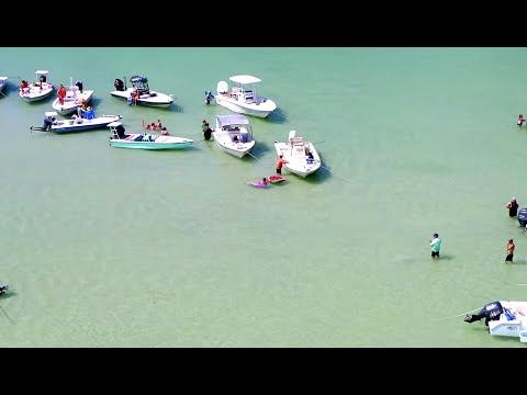 aerial-footage-of-boca-grande,-sandbar-party,-beach,-boats,-and-dolphins-2019