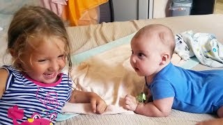 Cute Siblings Playing Together