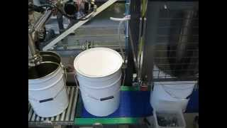 20 Litre Pail Net Weight Filling with manual lid placing and Semi-Auto latch lever application.