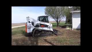 Bobcat T870 Compact Track Loader (CTL) grading yard