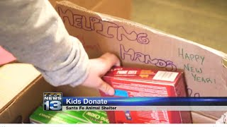 Elementary students donate dozens of items to homeless pets