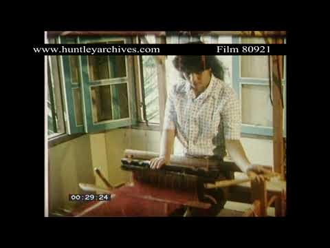 Indonesian Woman uses small hand loom, 1970's.  Archive film 80921
