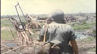 US Army Chaplain Captain Angelo Liteky looks at captured Vietcong equipment in So...HD Stock Footage
