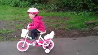 Kids Learning To Ride A Bike