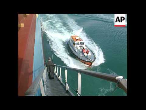 Egypt - Giant Ship Navigates Suez Canal