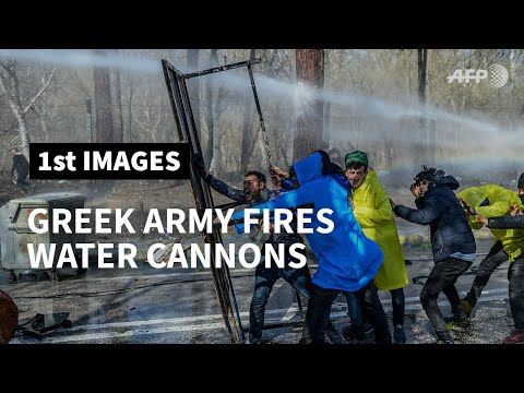 Greek army fires water cannon at migrants on the Turkish side of the border | AFP