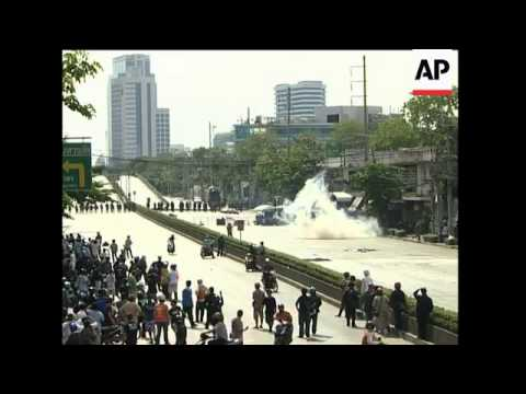 Troops fire teargas, burning barricades, injured protester