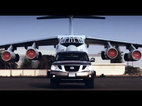Nissan Patrol 4WD vehicle tows 170.9-ton cargo plane at Sharjah Airport, UAE