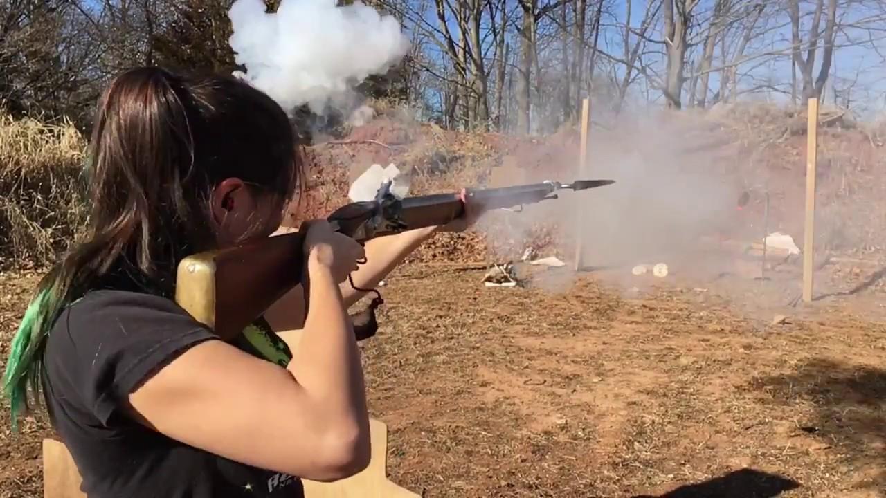 75 Caliber Brown Bess musket firing at steel plate
