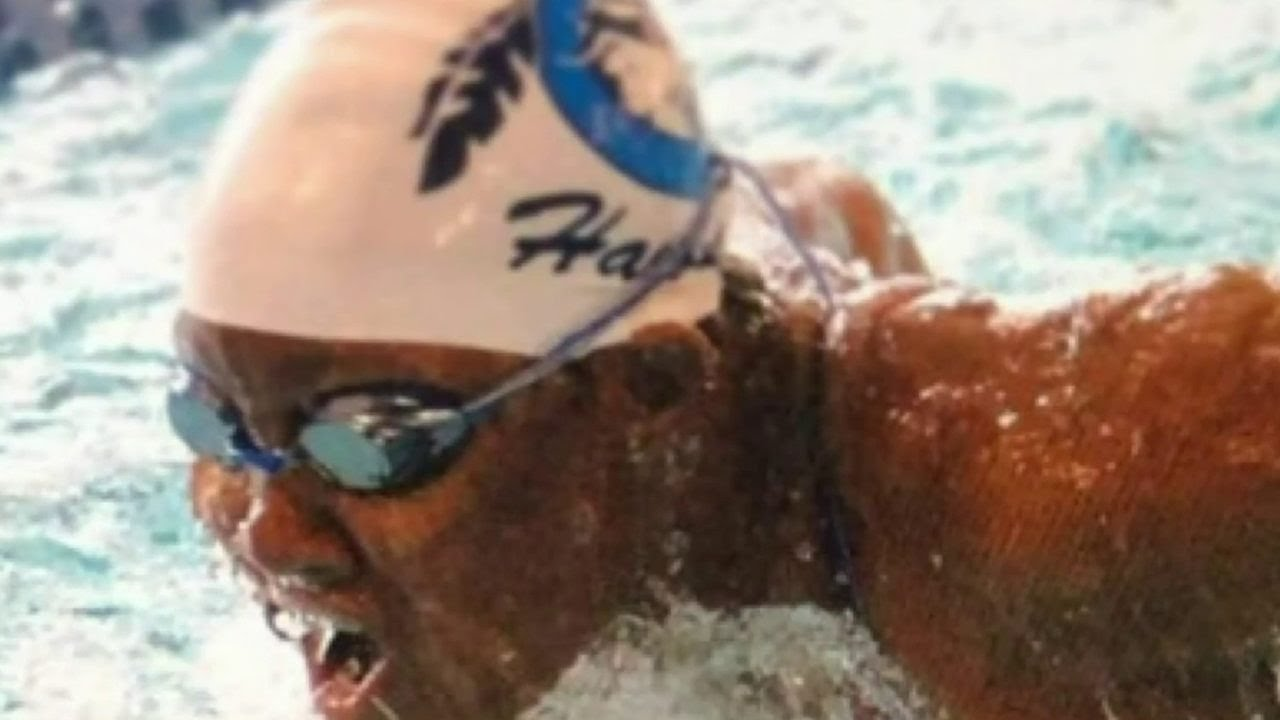 BLACK FEMALE DEAF SWIMMER IN DETROIT TRAINS TO TAKE ON THE WORLD