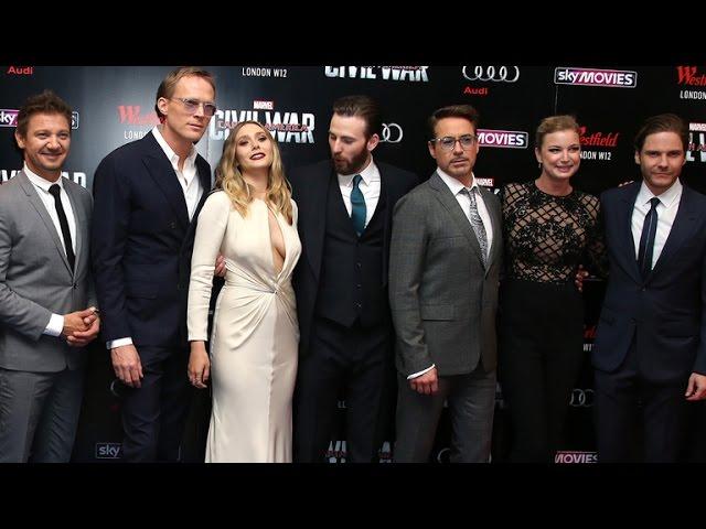 Chris Evans Can\'t Keep His Eyes Off Elizabeth Olsen\'s Chest at \'Captain America\: Civil War\' Premi…