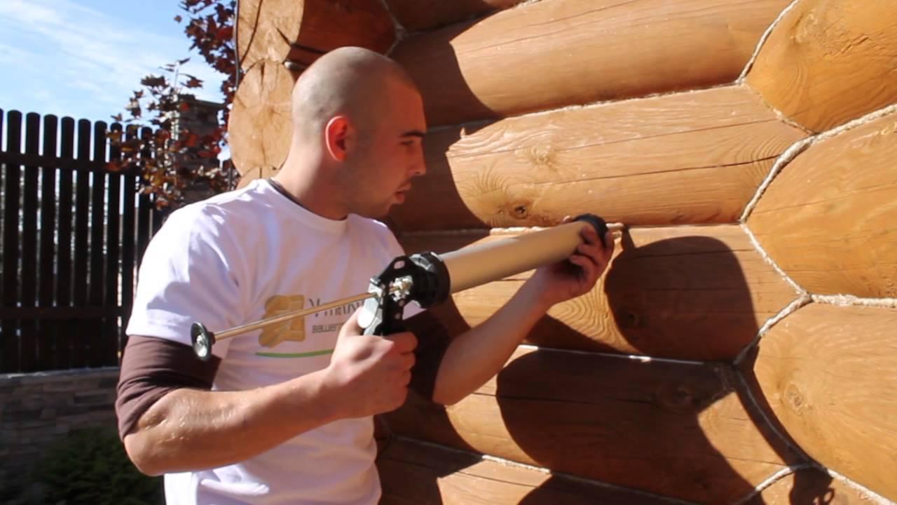 Герметизация и покраска деревянного дома из клееного бруса - YouTube