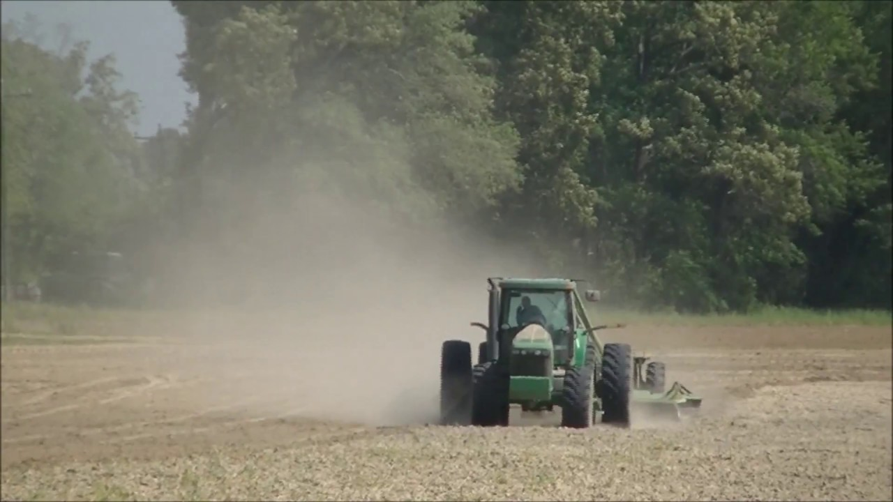 JOHN DEERE 8420 PULLING A LAND PLANE  PACIFIC TOMATOES LAND LEVELING