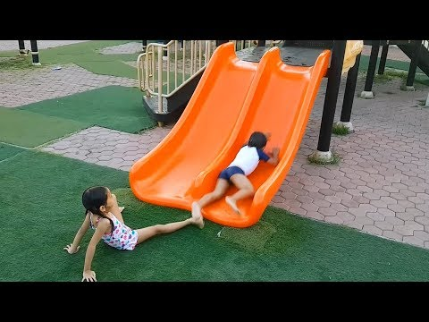 Playing In Rainy Waterpark Playground Slides With Funny Kids - Donna The Explorer