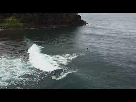 Surfers in Kauai by drone at Hanalei and Anini Beach