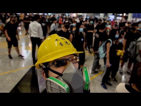 WATCH: Hong Kong protesters swarm airport for second straight day, again forcing cancelled flights: