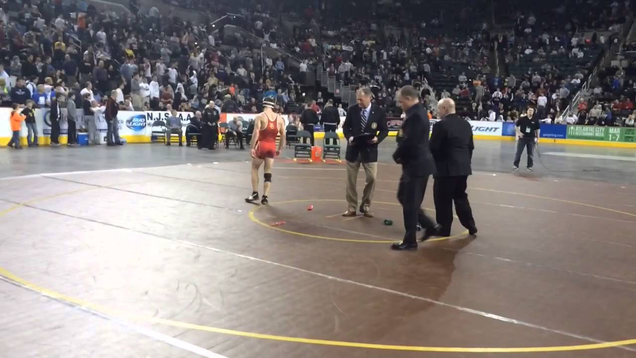 Wrestler Nick Suriano's victory ceremony at the 2016 State Wrestling Finals
