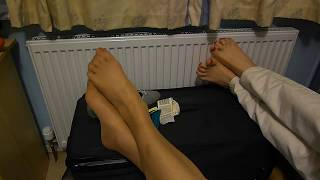2 pairs of feet on camera one bare one in nylon tights Thumbnail