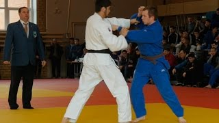 Young athletes judoists fight in competitions