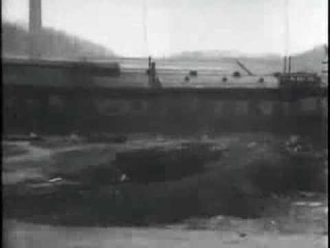 View from moving steam train in east Pittsburgh. 1904 historic film footage