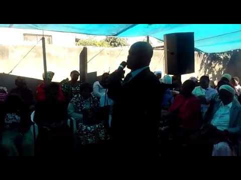 Seeding by pastor taguta at Bishop Burutu burial