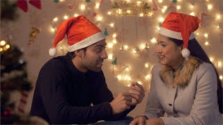 Adorable young Indian couple sharing special moments with each other on Christmas