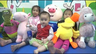 Baby and kids with funny animals at indoor playground and nursery rhymes songs - Story old macdonald