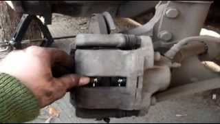 Dacia Logan. Замена передних тормозных колодок