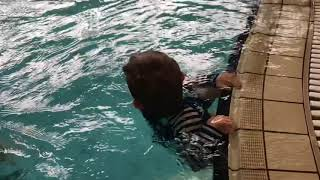 Toddler With Down Syndrome Learning To Swim