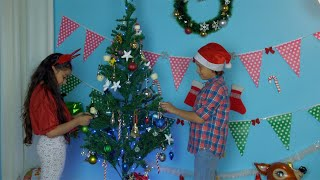 Young children happily decorating Christmas tree - festive season in India