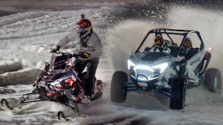 Polaris RZR vs. Snowmobile on Snowcross track!!