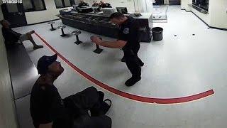 Cop Treats Handcuffed Man Like A Dog [VIDEO]