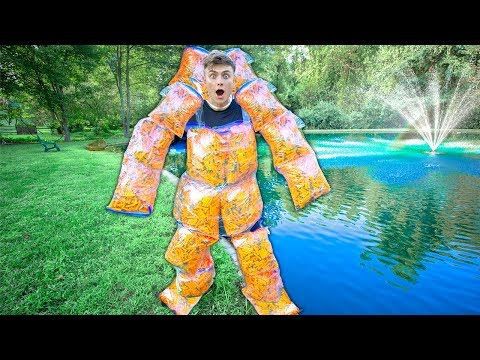 Can 10,000 FOAM DARTS Float A Person??