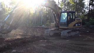 Cat 315D Ripping a Trench Through Hard Rock