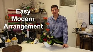 Modern flower arrangement with rolled leaf detail - ideal for home or in work situations -