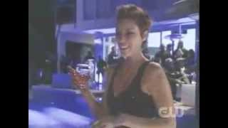 50 cent pushes model into a pool (Jael Strauss)