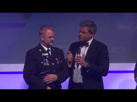 Police Bravery Awards 2016 - National winner PC Cannon accepts his award from the Home Sec